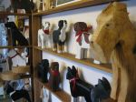 Dog carvings on shelves